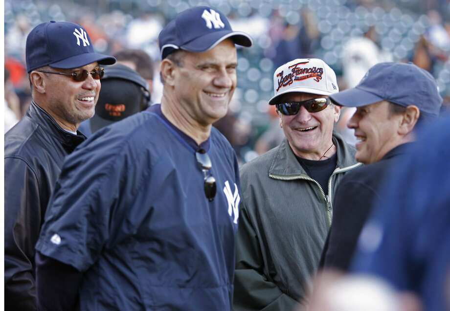 (Left to right) Reggie Jackson, Joe Torre and Billy Crystal enjoyed a moment with Robin Williams before a Yankees-Giants game in China Basin seven years ago. Photo: Kim Komenich, SFC