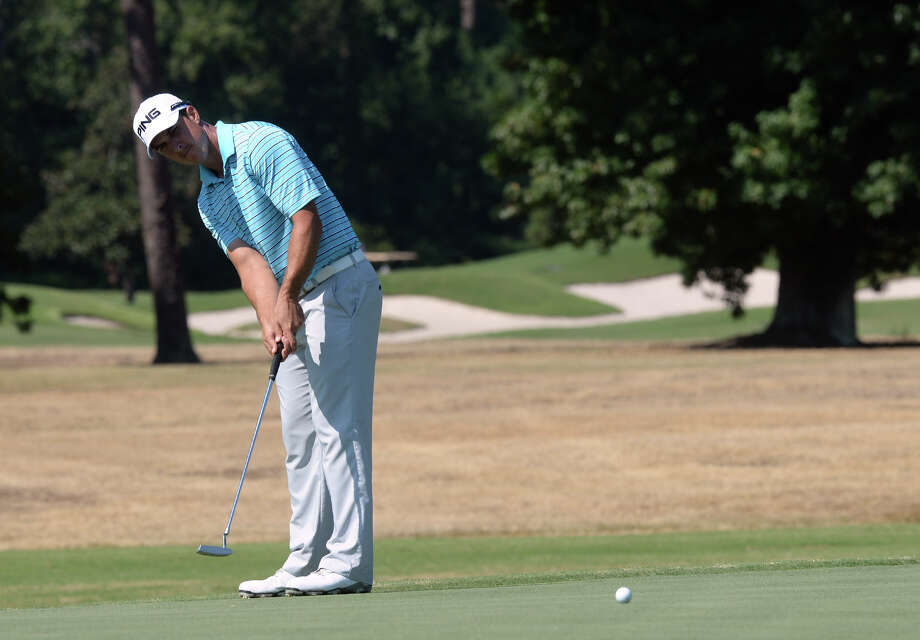 Anthony Broussard a former Kelly High School athlete  puts during the Adams Pro Tour's Southeast Texas Championship at the Beaumont Country Club on Wednesday.  Broussard enters Saturday's final round one stroke behind the leader.  Guiseppe Barranco/@spotnewsshooter Photo: Guiseppe Barranco, Photo Editor