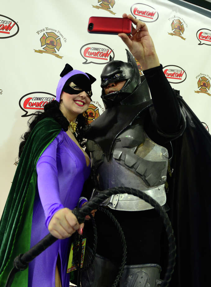 Jennifer Rose, as Catwoman, and Ruby Rinesko, at Batman, take a selfie during Connecticut ComiCONN at the Webster Bank Arena in downtown Bridgeport, Conn. on Friday, August 15, 2014. ComiCONN continues through Sunday. Photo: Christian Abraham / Connecticut Post