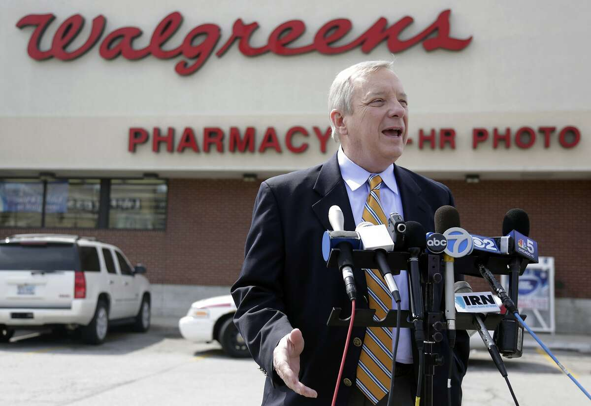 U.S. Sen. Dick Durbin, D-Ill. speaks during a news conference outside a Walgreen's drugstore Wednesday, Aug. 6, 2014, in Chicago. Durbin praised Walgreen, the nation's largest drugstore chain, for declining to pursue an overseas reorganization to trim its U.S. taxes. (AP Photo/M. Spencer Green)