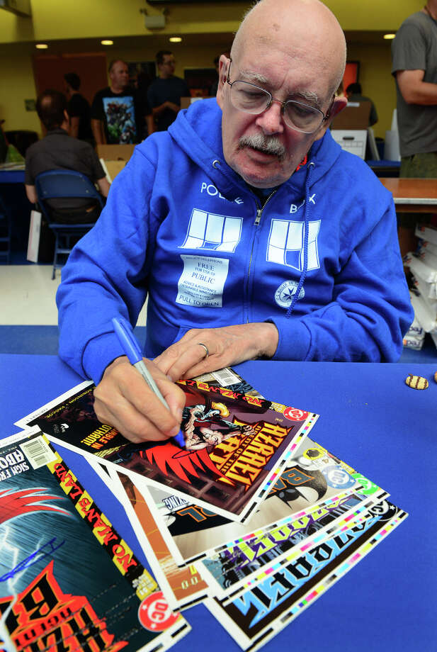 Legendary comic book writer Denny O'Neil signs autographs for his fans during Connecticut ComiCONN at the Webster Bank Arena in downtown Bridgeport, Conn. on Friday, August 15, 2014. ComiCONN continues through Sunday. Photo: Christian Abraham / Connecticut Post