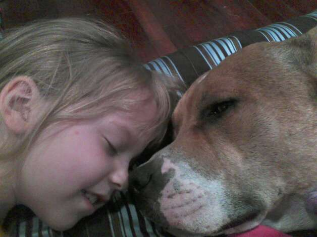 Gabrielle LaJoy enjoys a moment with the family pet, Rocco, earlier this summer at their Colonie home.  (Rick LaJoy)