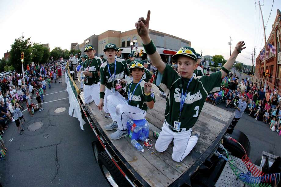 In this photo taken with a fisheye lens members of the Pearland East Little League team from Pearland,Texas ride in the Little League Grand Slam Parade as it makes its way through downtown Williamsport, Pa., Wednesday, Aug. 13, 2014. The Little League World Series tournament begins Thursday, August 14, in South Williamsport, Pa..  (AP Photo/Gene J. Puskar) Photo: Gene J. Puskar, STF / AP