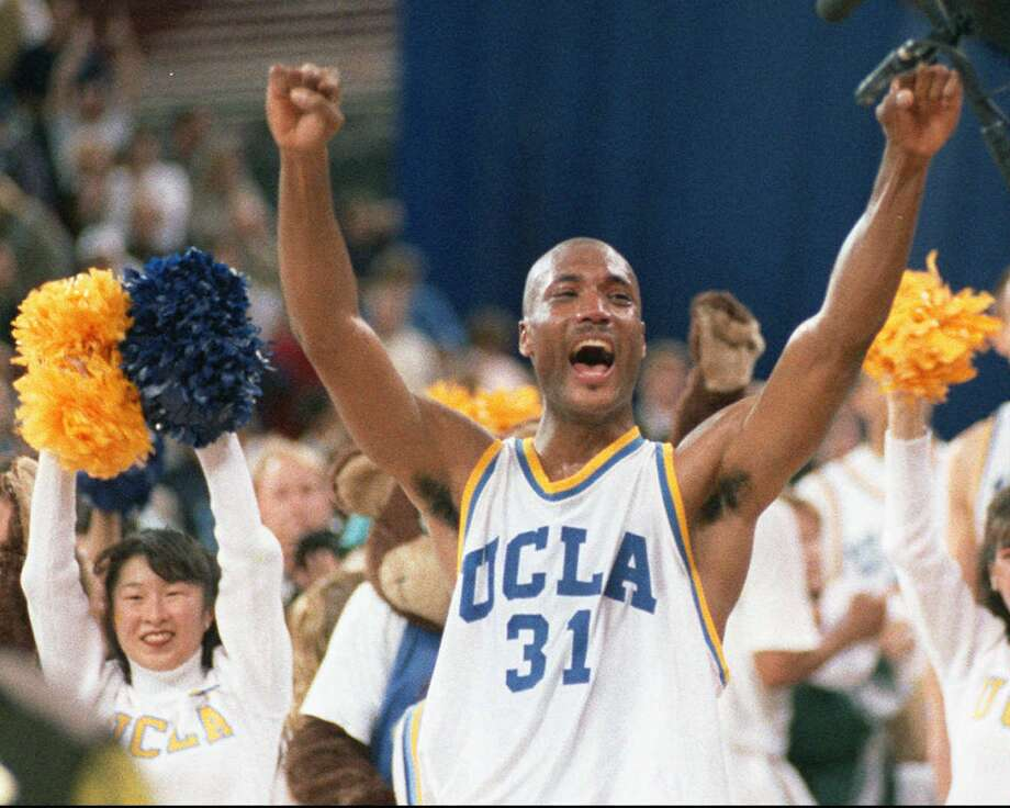 FILE - In this April 3, 1995 photo, UCLA's Ed O'Bannon celebrates after his team won the  championship NCAA game against Arkansas in Seattle. A federal judge has ruled that the NCAA can't stop college football and basketball players from selling the rights to their names and likenesses, opening the way to athletes getting payouts once their college careers are over, Friday, Aug. 8, 2014. (AP Photo/Eric Draper, File) Photo: ERIC DRAPER, STF / AP