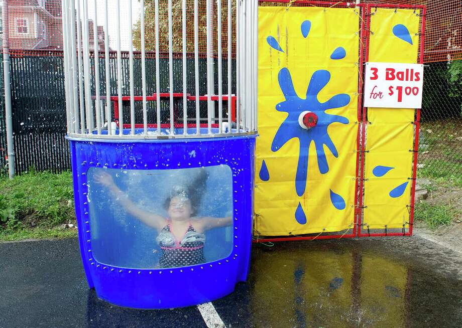 Hannah Fitzgerald, 11, is dunked in the dunk booth during the St. Catherine of Siena Church carnival in Greenwich, Conn., on August 15, 2014. Photo: Lindsay Perry / Stamford Advocate