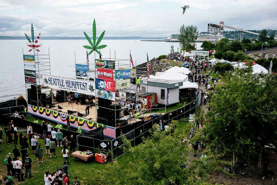Crowds begin to fill the grounds for Hempfest, Seattle's annual gathering to advocate the decriminalization of marijuana Friday, August 15, 2014, at Myrtle Edwards Park on the Seattle waterfront in Seattle, Washington. The three-day annual political rally, concert, and arts and crafts fair continues through Sunday. Photo: JORDAN STEAD, SEATTLEPI.COM / SEATTLEPI.COM