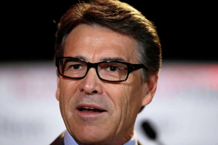 FILE - In this Friday, Aug. 8, 2014, file photo, Texas Gov. Rick Perry delivers a speech to nearly 300 in attendance at the 2014 RedState Gathering, in Fort Worth, Texas. Perry was indicted on Friday, Aug. 15, 2014, for abuse of power after carrying out a threat to veto funding for state public corruption prosecutors. (AP Photo/Tony Gutierrez, File) Photo: Tony Gutierrez, STF / AP