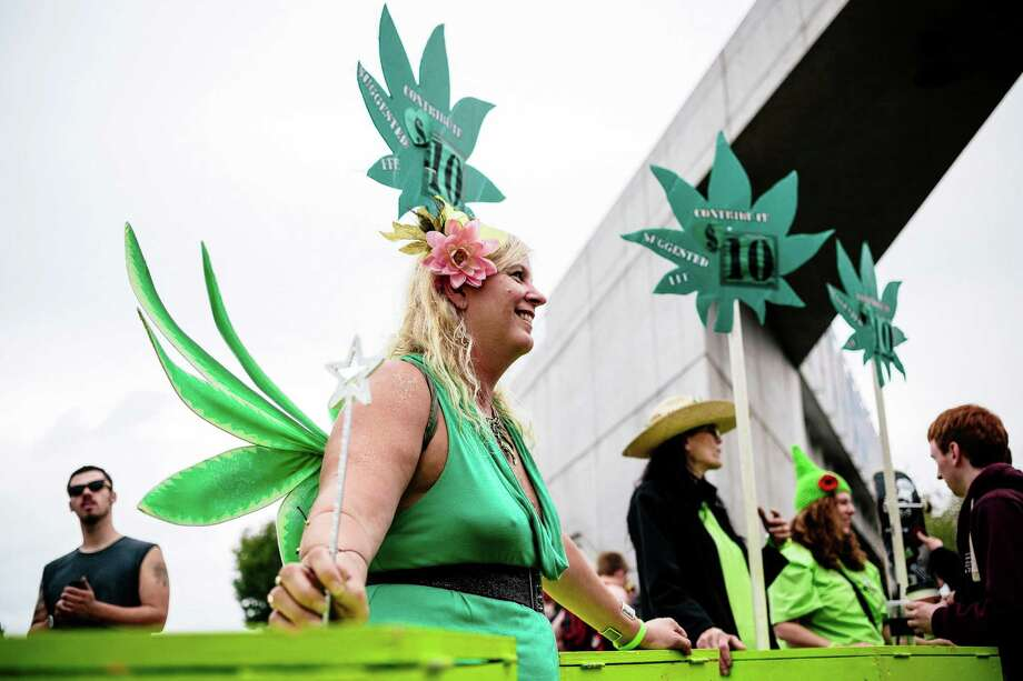 Leafy volunteers gather donations at the entryway to the first of three days of Hempfest, Seattle's annual gathering to advocate the decriminalization of marijuana Friday, August 15, 2014, at Myrtle Edwards Park on the Seattle waterfront in Seattle, Washington. The three-day annual political rally, concert, and arts and crafts fair continues through Sunday. Photo: JORDAN STEAD, SEATTLEPI.COM / SEATTLEPI.COM
