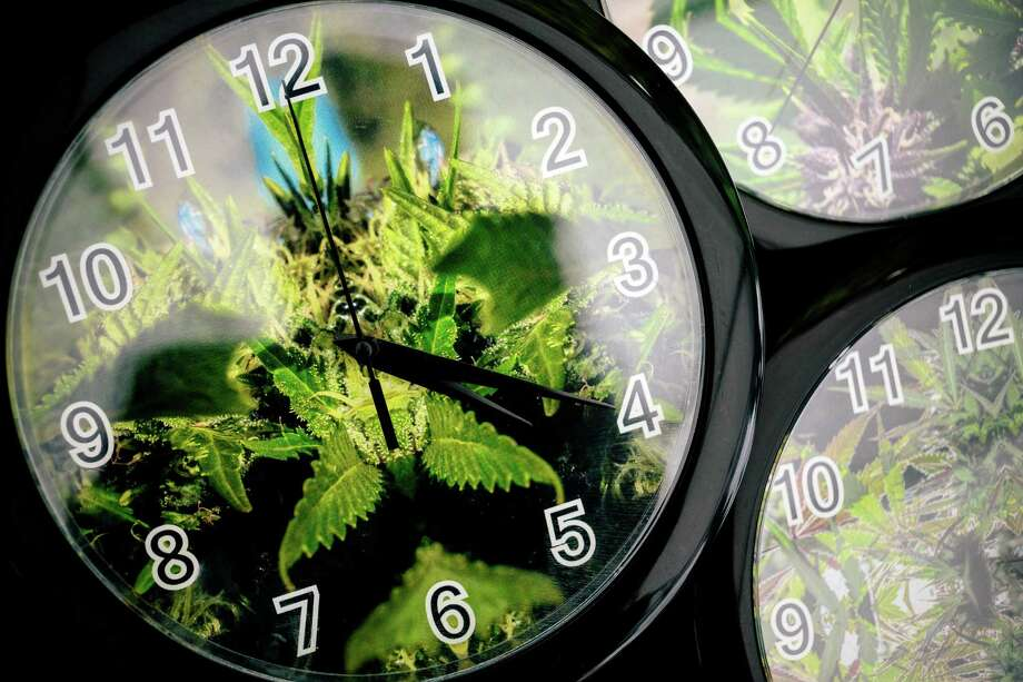 Set to the symbolic 4:20 time, weed patterns adorn clocks up for sale on the first of three days of Hempfest, Seattle's annual gathering to advocate the decriminalization of marijuana Friday, August 15, 2014, at Myrtle Edwards Park on the Seattle waterfront in Seattle, Washington. The three-day annual political rally, concert, and arts and crafts fair continues through Sunday. Photo: JORDAN STEAD, SEATTLEPI.COM / SEATTLEPI.COM