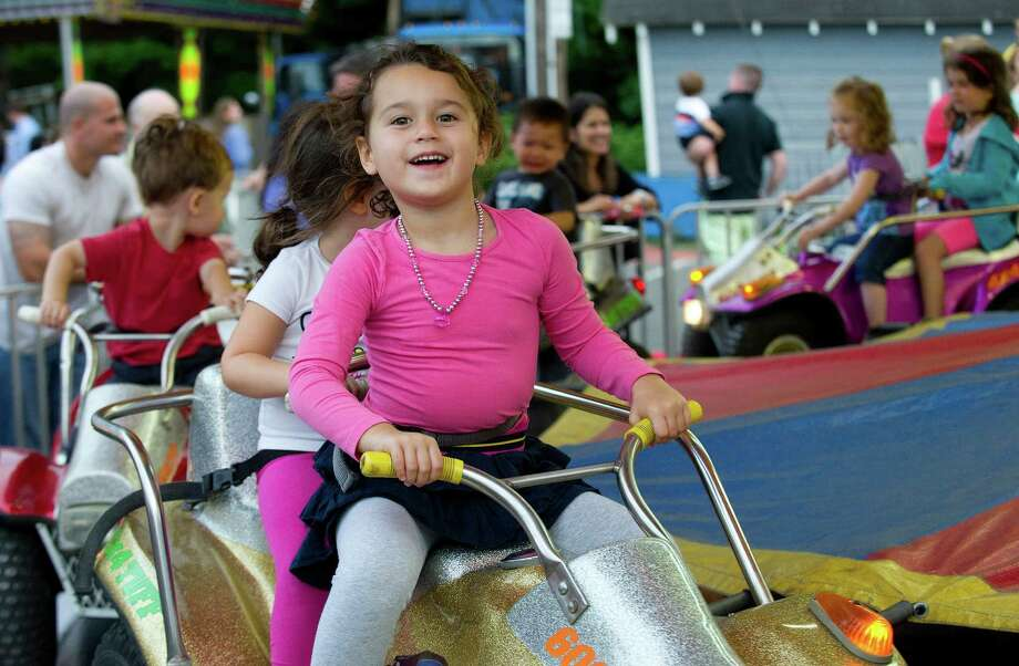 Joanna Eken, 4, goes on a ride during the St. Catherine of Siena Church carnival in Greenwich, Conn., on August 15, 2014. Photo: Lindsay Perry / Stamford Advocate