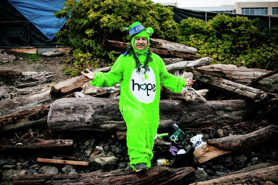 "Street performer Isaiah John, dressed as the ""Hope For Dope"" bear, preps his outfit inside the fences of Hempfest, Seattle's annual gathering to advocate the decriminalization of marijuana Friday, August 15, 2014, at Myrtle Edwards Park on the Seattle waterfront in Seattle, Washington. The three-day annual political rally, concert, and arts and crafts fair continues through Sunday. Photo: JORDAN STEAD, SEATTLEPI.COM / SEATTLEPI.COM"
