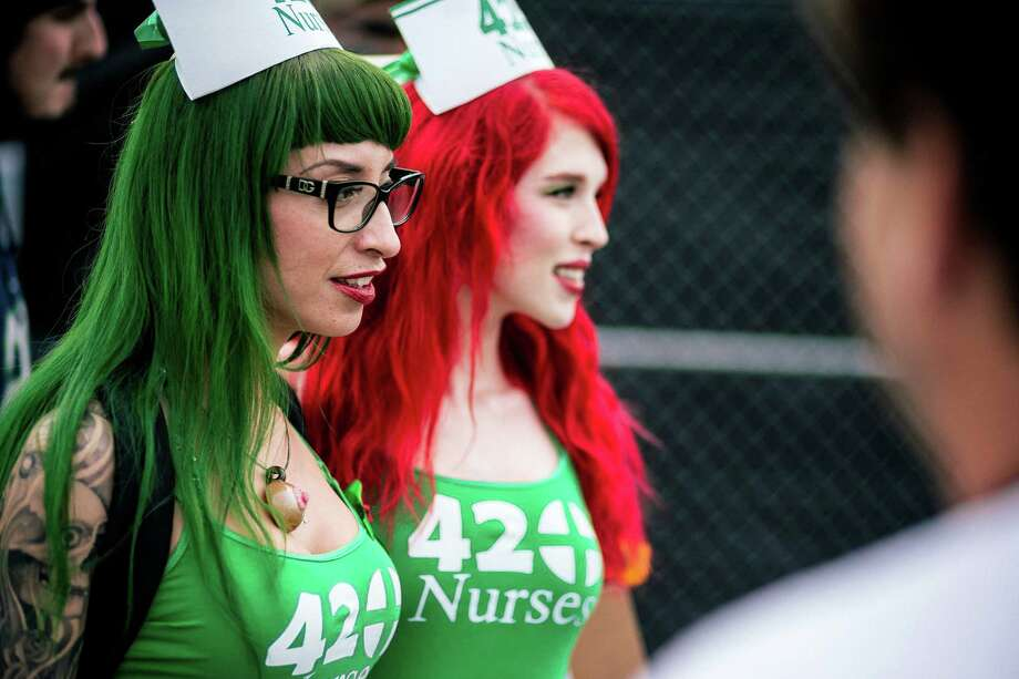 "Self-titled ""420 Nurses"" navigate the grounds of Hempfest, Seattle's annual gathering to advocate the decriminalization of marijuana Friday, August 15, 2014, at Myrtle Edwards Park on the Seattle waterfront in Seattle, Washington. The three-day annual political rally, concert, and arts and crafts fair continues through Sunday. Photo: JORDAN STEAD, SEATTLEPI.COM / SEATTLEPI.COM"