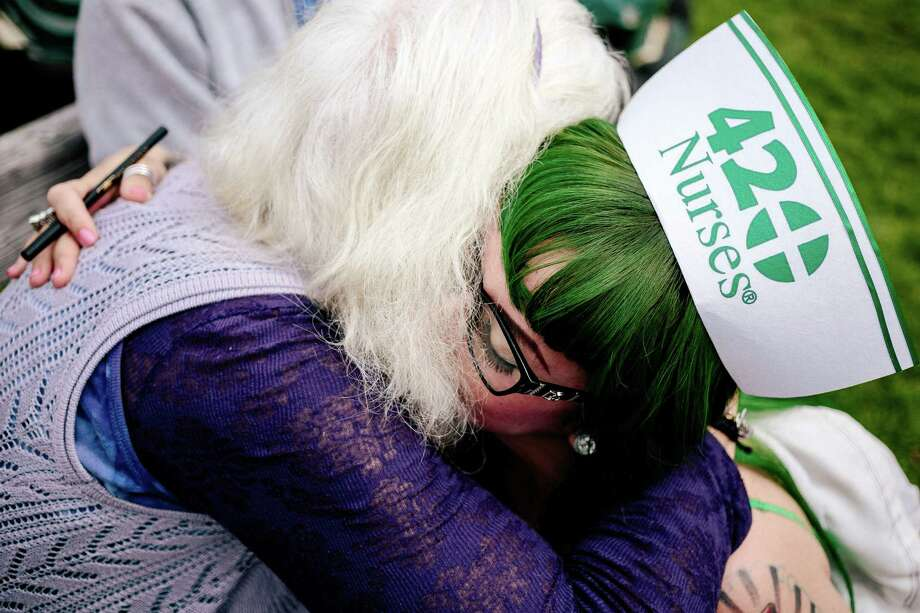 "Cha Cha Vavoom, a ""420 Nurse,"" right, tearfully embraces retired nurse, Kathie Zamanjahromi, left, at Hempfest, Seattle's annual gathering to advocate the decriminalization of marijuana Friday, August 15, 2014, at Myrtle Edwards Park on the Seattle waterfront in Seattle, Washington. Zamanjahromi is a pro-marijuana advocate. The three-day annual political rally, concert, and arts and crafts fair continues through Sunday. Photo: JORDAN STEAD, SEATTLEPI.COM / SEATTLEPI.COM"