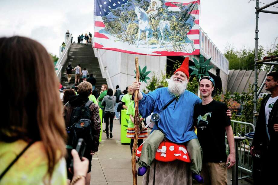 "Attendees pose with the ""door gnome"" on the first of three days of Hempfest, Seattle's annual gathering to advocate the decriminalization of marijuana Friday, August 15, 2014, at Myrtle Edwards Park on the Seattle waterfront in Seattle, Washington. The three-day annual political rally, concert, and arts and crafts fair continues through Sunday. Photo: JORDAN STEAD, SEATTLEPI.COM / SEATTLEPI.COM"