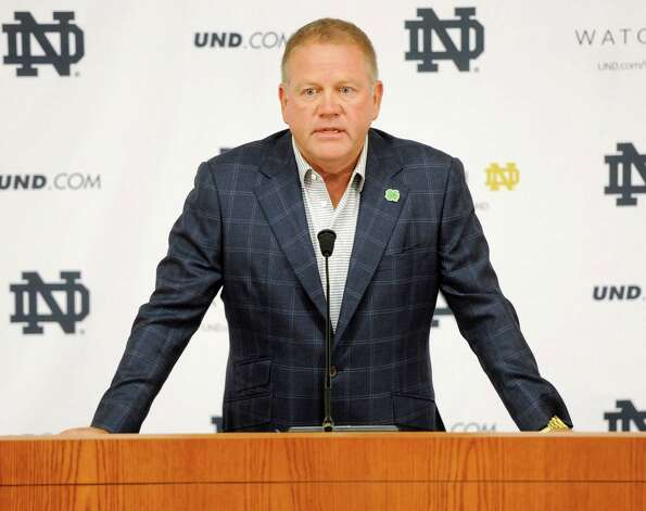 """FILE - In this Aug. 1, 2014, file photo, Notre Dame football coach Brian Kelly talks to the media at the beginning of fall practice in South Bend, Ind. Notre Dame says it is investigating """"suspected academic dishonesty"""" involving several students, including four members of the football team. The school released a statement Friday, Aug. 15 saying it has notified the NCAA and that because of potential NCAA violations the four players are being held out of practice and completion until the conclusion of the investigation and the university honor code process. (AP Photo/Joe Raymond, File) ORG XMIT: NY169 Photo: JOE RAYMOND / FR25092 AP"""