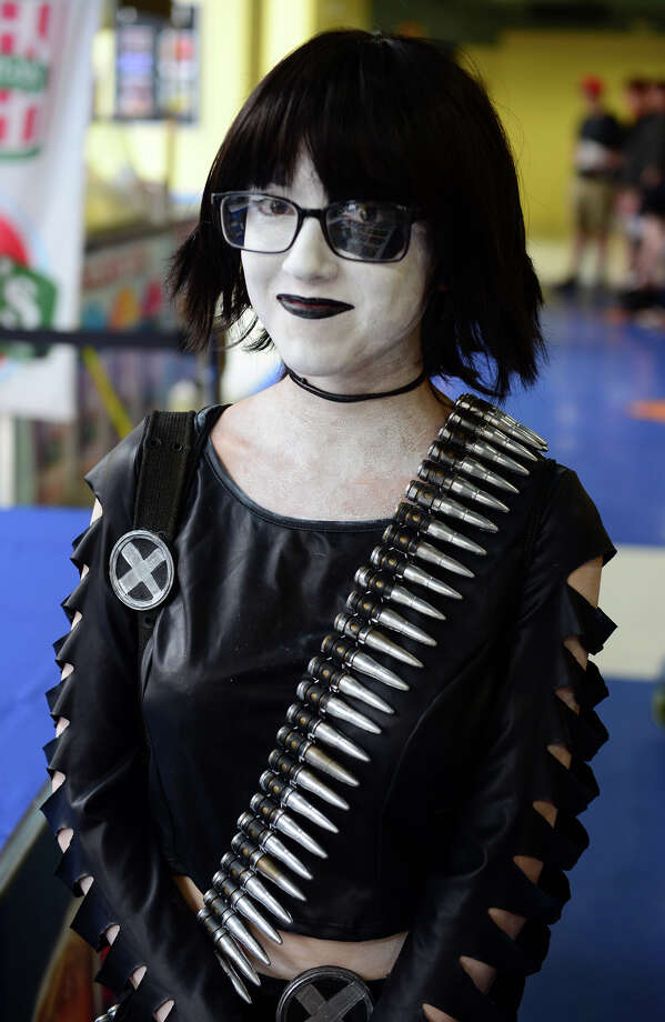 Alondria Medina, of Bridgeport, is dressed up as Domino from X-Men, during Connecticut ComiCONN at the Webster Bank Arena in downtown Bridgeport, Conn. on Friday, August 15, 2014. Photo: Christian Abraham / Connecticut Post