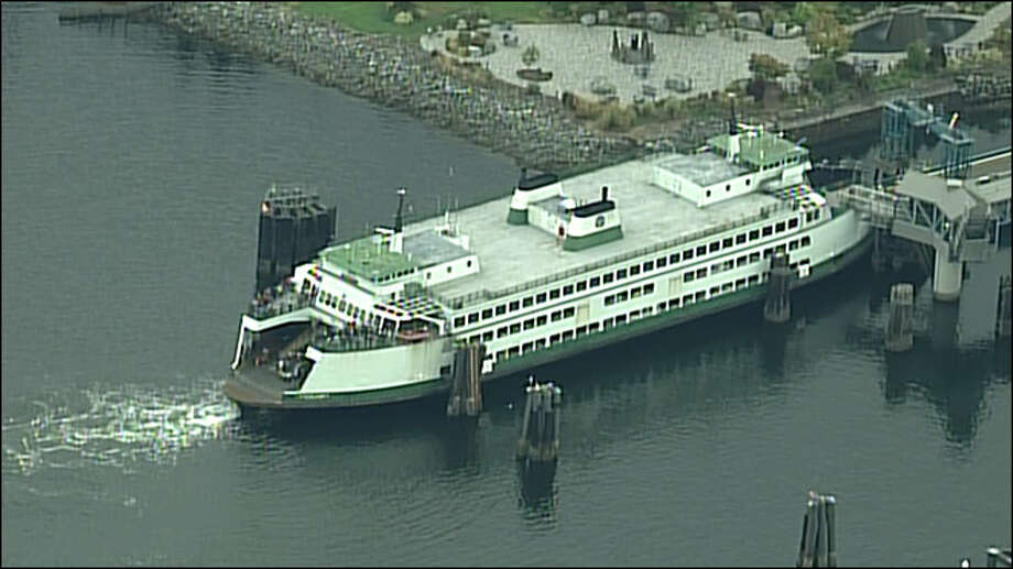 The 4:20 p.m. sailing of the M/V Cathlamet sits at the Bremerton ferry dock awaiting overflow passengers to disembark before setting sail for Seattle.
