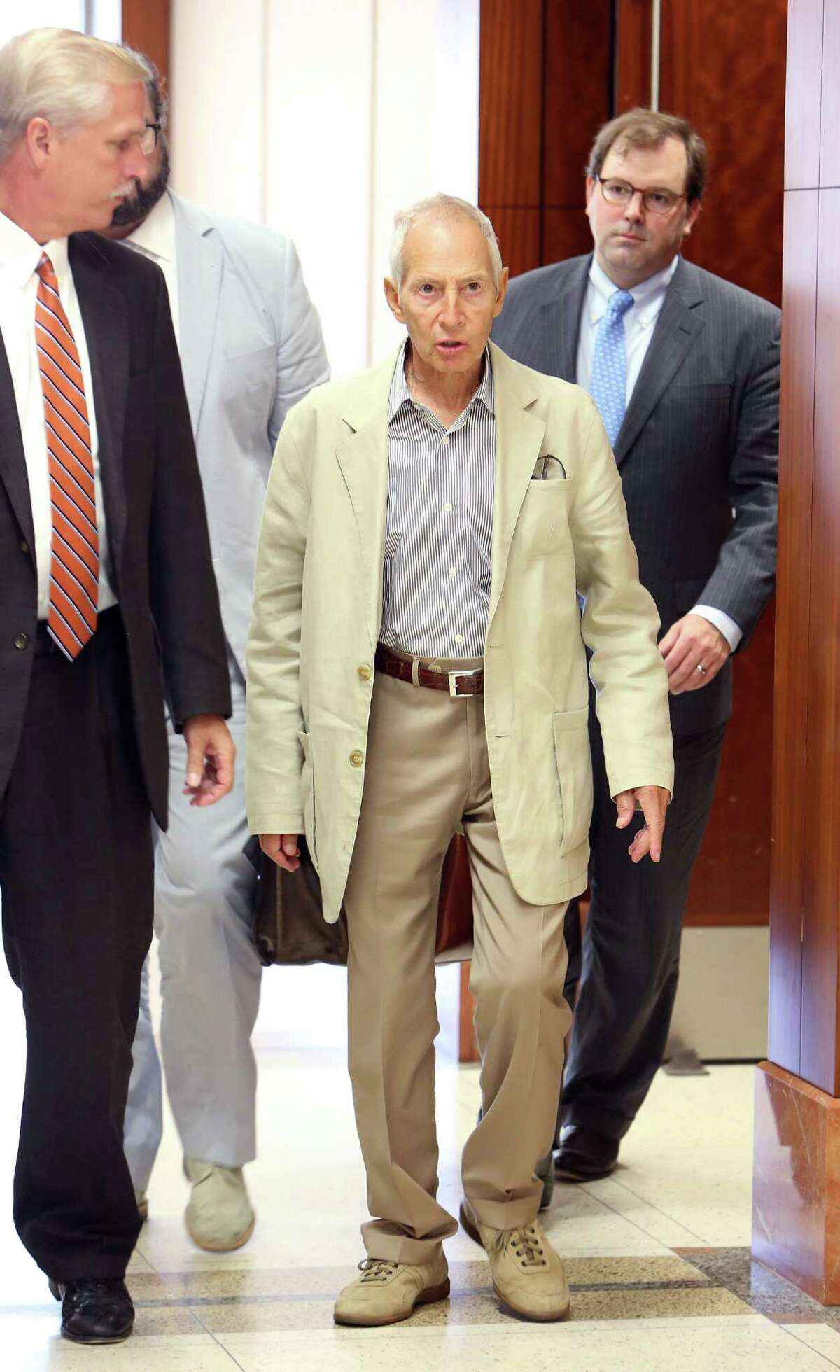 Robert Durst walks out of court after resetting his hearing at the Harris County Criminal Justice Center in August 2014.