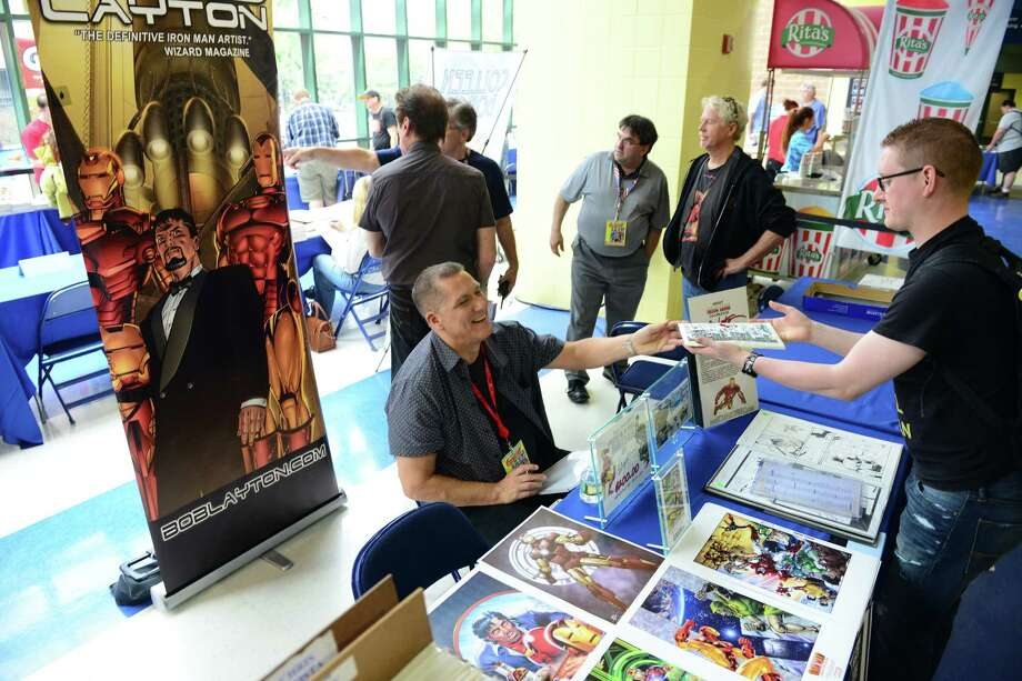 Bob Layton, writer and artist on Iron Man, signs autographs for fans during Connecticut ComiCONN at the Webster Bank Arena in downtown Bridgeport, Conn. on Friday, August 15, 2014. ComiCONN continues through Sunday. Photo: Christian Abraham / Connecticut Post