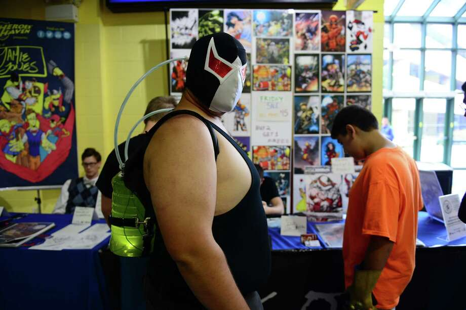 Parker Dumont, of Durham, portrays Batman villian Bane, during Connecticut ComiCONN at the Webster Bank Arena in downtown Bridgeport, Conn. on Friday, August 15, 2014. ComiCONN continues through Sunday. Photo: Christian Abraham / Connecticut Post