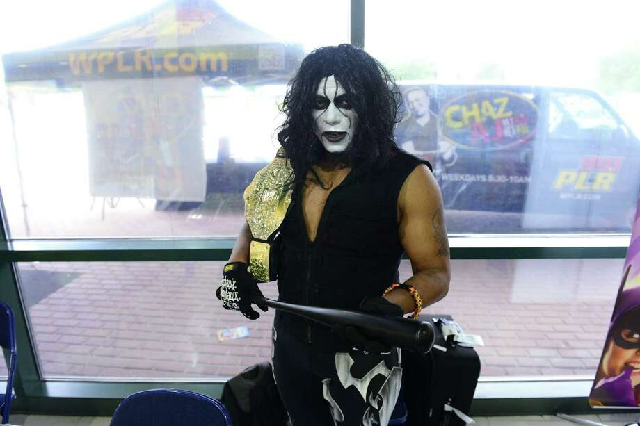 Michael Wilson plays the WWE wrestler Sting, during Connecticut ComiCONN at the Webster Bank Arena in downtown Bridgeport, Conn. on Friday, August 15, 2014. ComiCONN continues through Sunday. Photo: Christian Abraham / Connecticut Post