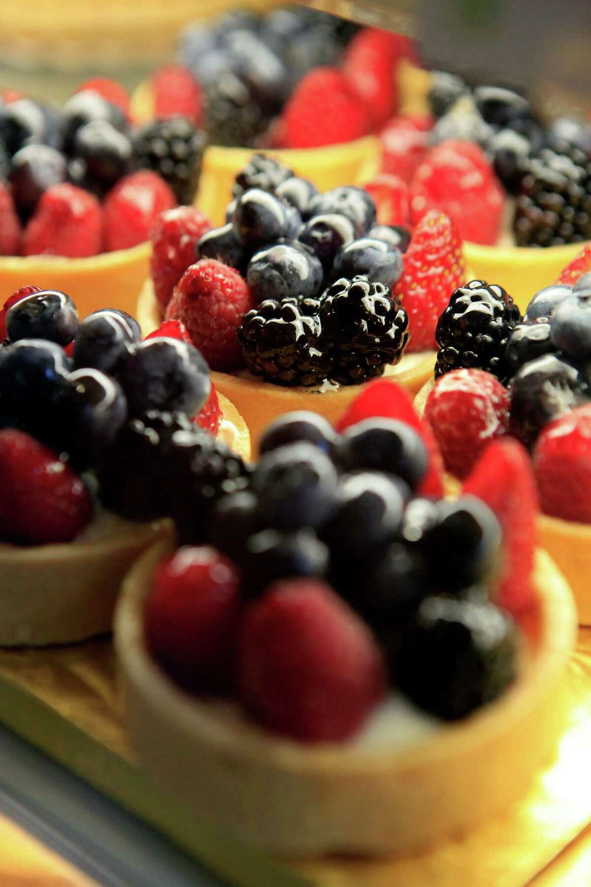 Fresh berry tarts are seen on display at Noe Valley Bakery in San Francisco, CA, Friday, August 8, 2014.