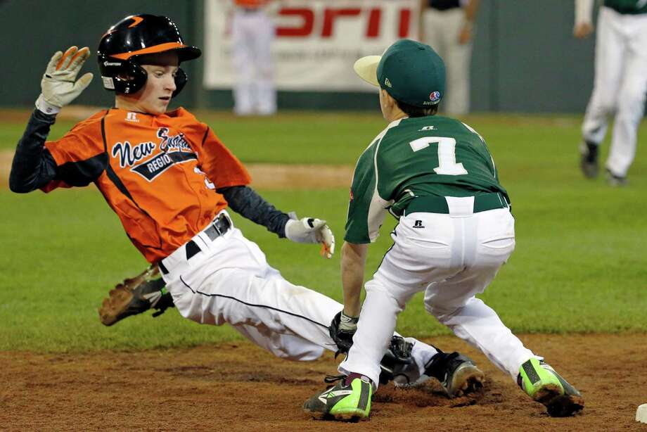 Pearland third baseman Presley Smith (7) tags out Cumberland's CJ Davock attempting to steal third to end the third inning of a baseball game in United States pool play at the Little League World Series tournament in South Williamsport, Pa., Friday, Aug. 15, 2014. (AP Photo/Gene J. Puskar) Photo: Gene J. Puskar, Associated Press / AP