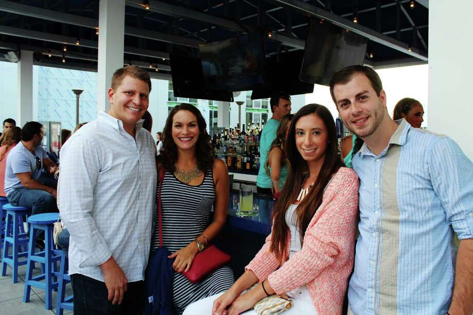 As part of its grand opening weekend, Sign of the Whale held a VIP reception and charity event Friday, August 15, 2014 at its new Stamford location. The roof-top bar opened on Harbor Point Road on Thursday, August 14, 2014. Proceeds from Friday's event went to the Whale and Dolphin Conservation. Were you SEEN at Sign of the Whale on Friday, August 15? Photo: Michelle Russo / Hearst Connecticut Media Group