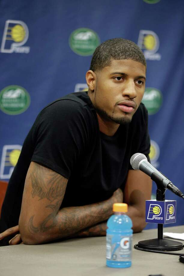 "Indiana Pacers' Paul George listens to a question during a news conference Friday, Aug. 15, 2014, in Indianapolis. George hopes to make it back on the court next season despite the ""freak accident"" that caused a compound fracture in his right leg. (AP Photo/Darron Cummings)  ORG XMIT: INDC103 Photo: Darron Cummings / AP"