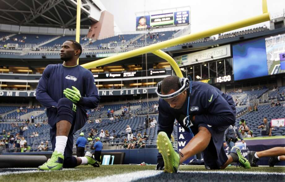 Seattle Seahawks wide receivers Percy Harvin, right, and Ricardo Lockette, left, stretch before the start of a preseason NFL football game against the San Diego Chargers, Friday, Aug. 15, 2014, in Seattle. (AP Photo/John Froschauer) Photo: AP