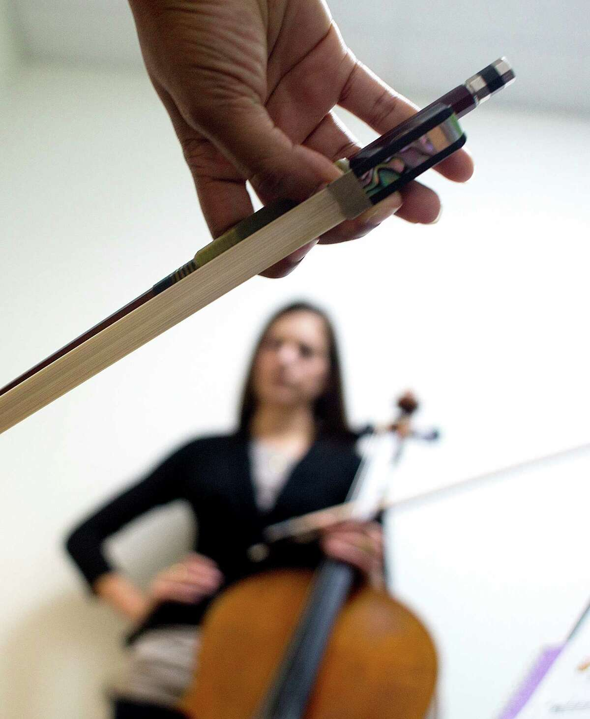 Instructor Annamarie Reader listens as a student practices at the Vivaldi Music Academy in Bellaire.