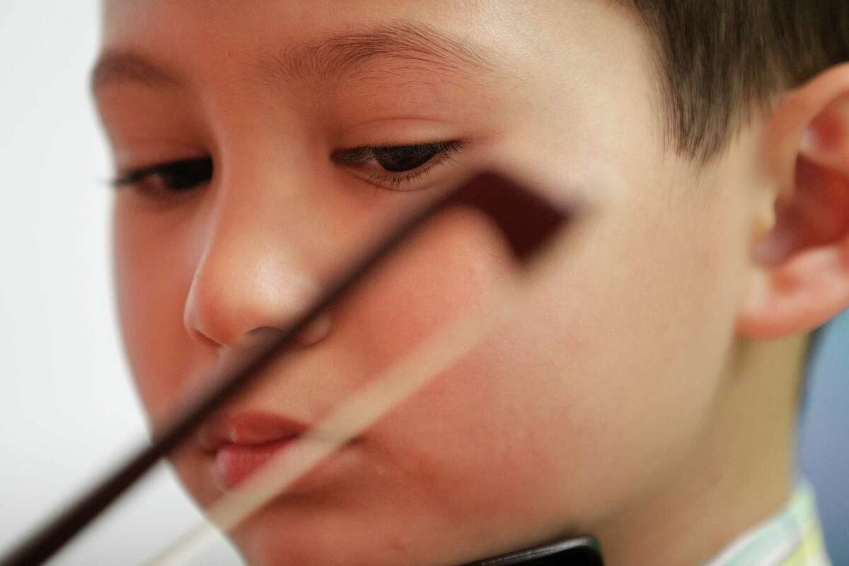 Karel McMayon, 5, practices his violin, at the Vivaldi Music Academy Friday, July 18, 2014, in Houston. Vivaldi Music Academy's owner, Zeljko Pavlovic, is a world-class violinist from Bosnia who came here to escape the war. The violin academy at 3914 Gramercy Street has more than 30 faculty members providing various lessons from early childhood music development, to piano, cello, French horn and voice. ( Johnny Hanson / Houston Chronicle )