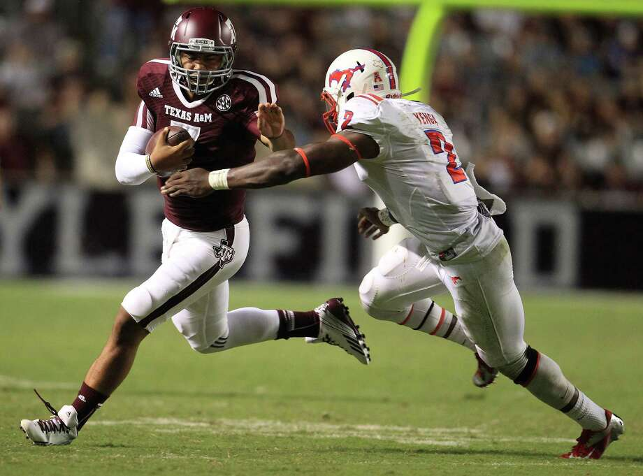 Texas A&M sophomore quarterback Kenny Hill, left, who spent last season as the backup to Johnny Manziel, is locked in a fierce battle with freshman Kyle Allen for the starting job. Photo: Karen Warren, Staff / © 2013 Houston Chronicle