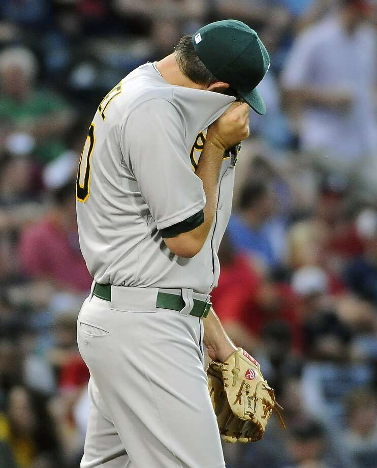 Jason Hammel wipes his face after giving up the second of two homers in the second inning. Photo: Dave Tulis, Associated Press