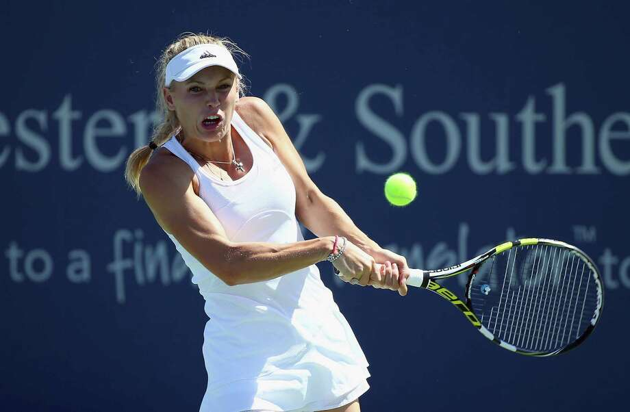 CINCINNATI, OH - AUGUST 15:  Caroline Wozniacki of Denmark hits a return during the match against Agnieszka Radwanska of Poland on Day 7 of the Western & Southern Open on August 15, 2014 at the Linder Family Tennis Center in Cincinnati,Ohio. Photo: Andy Lyons, Getty Images / 2014 Getty Images