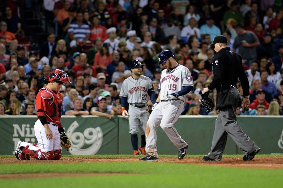 With a tap of his foot on home plate, Robbie Grossman completes his tour of the bases following his tying home run in the seventh for the Astros. Photo: Darren McCollester, Getty Images / 2014 Getty Images