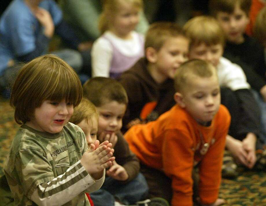 The Living Dragons Reptile Show visited the Stratford Public Library, Thursday, Feb. 18, 2010. Children were able to touch and see exotic reptiles close up. Photo: Phil Noel / Connecticut Post