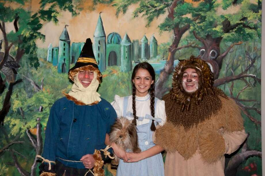 Dorothy, played by Greenwich resident Liz Stillman, center, is joined by her fellow band of travelers as they make their way down the yellow brick road, including Stamford residents Matt Victory as the Scarecrow and Tony Morello as the Cowardly Lion. Photo: Contributed Photo, Contributed Photo/Katheen Di Giovanna / Stamford Advocate Contributed