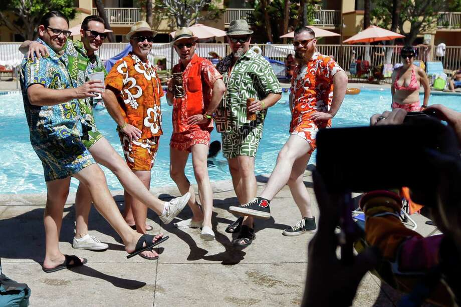 Men pose for a picture during the Tiki Oasis event Friday, Aug. 15, 2014, in San Diego. Hundreds of tiki culture aficionados, clad in tropical colors, gathered Friday for a weekend-long celebration that revels in the movements from the 1950s and 1960s.  Photo: Gregory Bull, Associated Press / AP