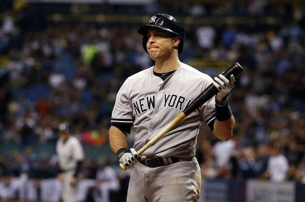 ST. PETERSBURG, FL - AUGUST 15:  Mark Teixeira #25 of the New York Yankees reacts after striking out looking with the bases loaded to end the top of the eighth inning of a game against the Tampa Bay Rays on August 15, 2014 at Tropicana Field in St. Petersburg, Florida.  (Photo by Brian Blanco/Getty Images) ORG XMIT: 477588031 Photo: Brian Blanco / 2014 Getty Images