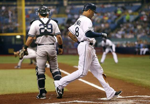 ST. PETERSBURG, FL - AUGUST 15:  Desmond Jennings #8 of the Tampa Bay Rays crosses home plate ahead of catcher Francisco Cervelli #29 of the New York Yankees to score off a fielder's choice by Evan Longoria during the first inning of a game on August 15, 2014 at Tropicana Field in St. Petersburg, Florida.  (Photo by Brian Blanco/Getty Images) ORG XMIT: 477588031 Photo: Brian Blanco / 2014 Getty Images