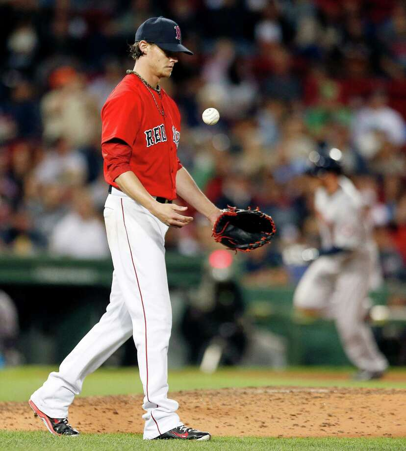 Boston Red Sox's Clay Buchholz tosses the ball after giving up a solo home run to Houston Astros' Robbie Grossman during the seventh inning of a baseball game in Boston, Friday, Aug. 15, 2014. (AP Photo/Michael Dwyer) ORG XMIT: MAMD108 Photo: Michael Dwyer / AP