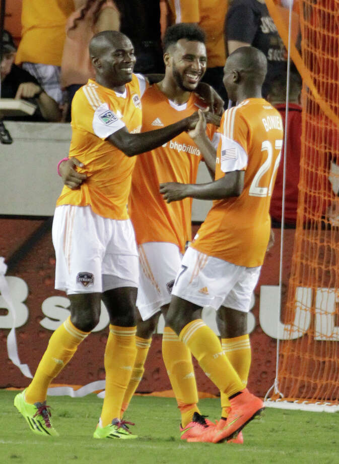 Houston Dynamo Omar Cummings , left, celebrates his second half goal with teammates Giles Barnes, center, and Boniek Garcia, right, in game against the Philadelphia Union at BBVA Compass Stadium Friday, Aug. 15, 2014, in Houston. Photo: Melissa Phillip, Houston Chronicle / © 2014  Houston Chronicle