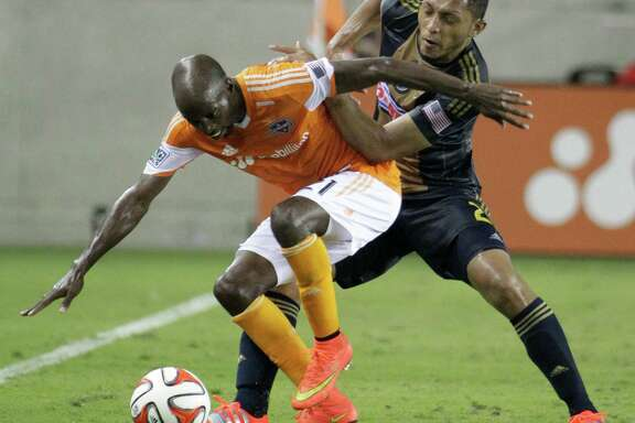 Houston Dynamo DaMarcus Beasley tries to control the ball ahead of Philadelphia Union Carlos Valdes during the second half of game at BBVA Compass Stadium Friday, Aug. 15, 2014, in Houston.