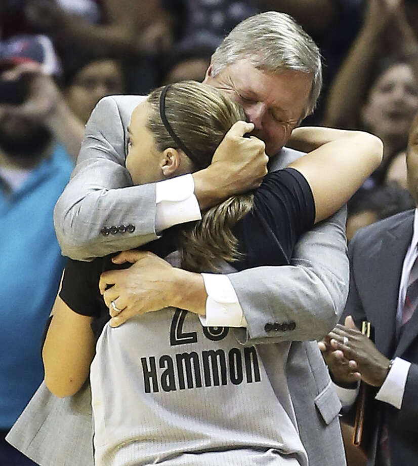 Stars coach Dan Hughes hugs Becky Hammon, who had seven points and 10 assists in her final regular-season home game. Photo: Tom Reel / San Antonio Express-News