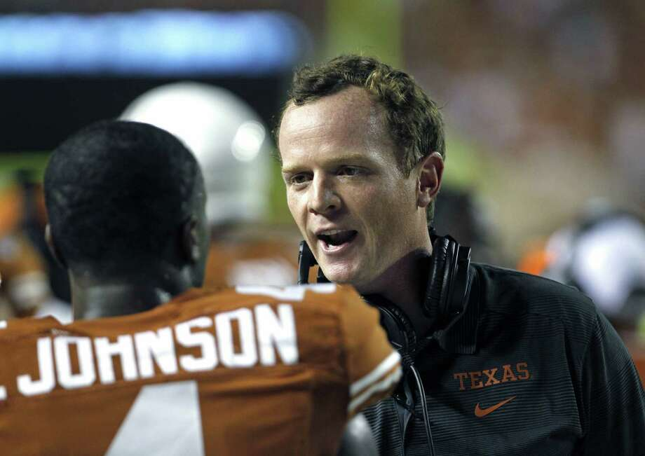 Former Texas offensive coordinator Major Applewhite admitted to a one-time indiscretion with a student trainer in 2013. He received a letter of reprimand but was allowed to keep his job. Photo: Michael Thomas / Associated Press / FR65778 AP