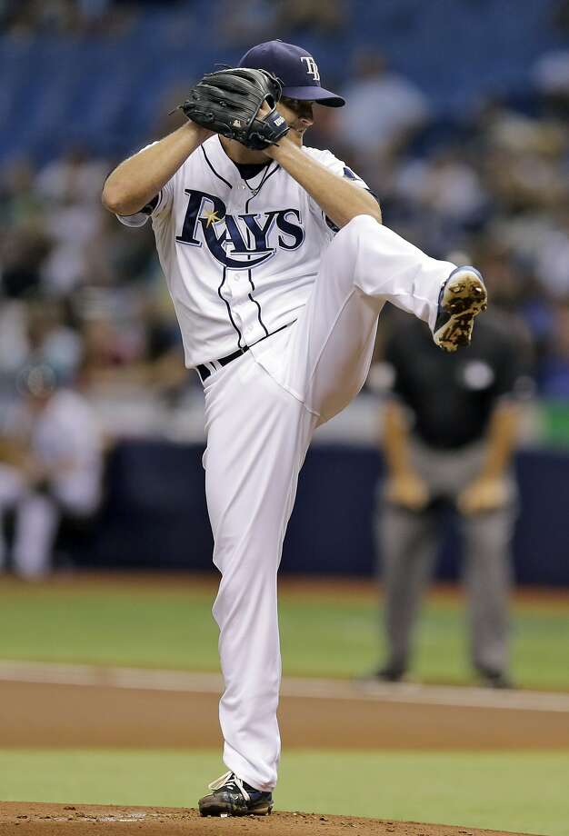 Tampa Bay Rays starting pitcher Alex Cobb goes into his windup against the New York Yankees during the first inning of a baseball game Friday, Aug. 15, 2014, in St. Petersburg, Fla. (AP Photo/Chris O'Meara) Photo: Chris O'Meara, Associated Press