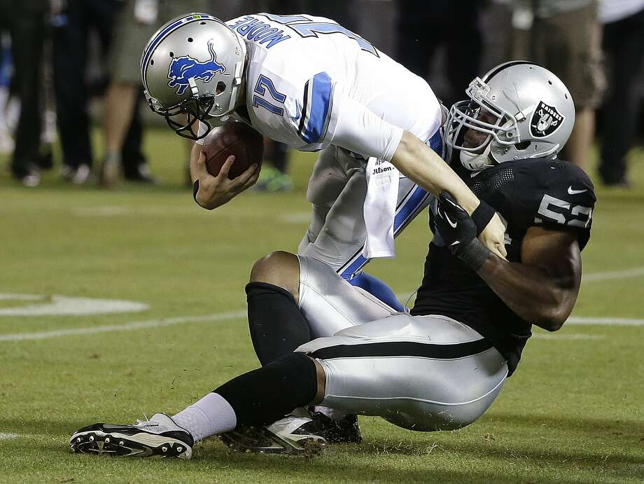 Oakland Raiders outside linebacker Khalil Mack (52) tackles Detroit Lions quarterback Kellen Moore (17) during the second half of an NFL preseason football game in Oakland, Calif., Friday, Aug. 15, 2014. (AP Photo/Marcio Jose Sanchez) Photo: Marcio Jose Sanchez, Associated Press