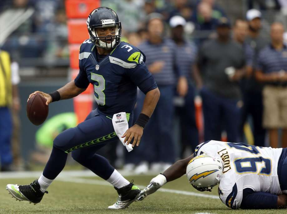 QB Russell WilsonPreseason games are mainly about the backups, as a roster of 90 will soon be reduced to 53.   But Seattle's golden boy, quarterback Russell Wilson, looked like a bona fide MVP on Friday.   He was calm and collected. He was relaxed and poised. And he looked unsackable, darting away   from pressure with ease. If this is what Wilson looks like when he gets protection from his   O-line, Seattle's offense could be much scarier than expected. Wilson took a seat just before   halftime, finishing the tilt 11-for-13 through the air with 121 passing yards and a rating of   105.4. Oh, and he scored two touchdowns on the ground, rushing four times for 31 yards. (Four   of Seattle's five TDs came on QB keepers.)— Nick Eaton Photo: Otto Greule Jr, Getty Images