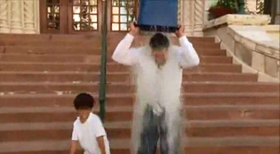 District 8 City Councilman Ron Nirenberg and his son take the ALS ice bucket challenge Friday, Aug. 15, 2014, on the step of San Antonio's City Hall. Photo: Screengrab From Video